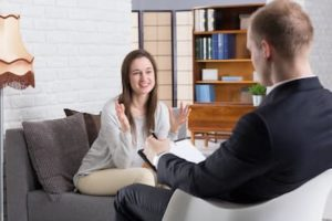 a woman talking to her doctor about depression treatment